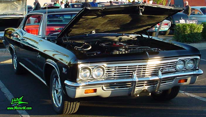 Photo of a black 1966 Chevrolet Caprice 2 door hardtop coupe at the Scottsdale Pavilions Classic Car Show in Arizona. 1966 Chevrolet Caprice