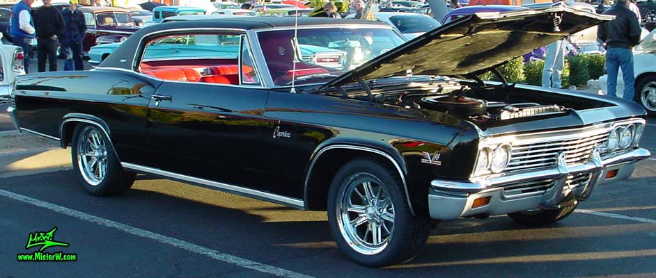 Photo of a black 1966 Chevrolet Caprice 2 door hardtop coupe at the Scottsdale Pavilions Classic Car Show in Arizona. 1966 Chevy Caprice front chrome grill