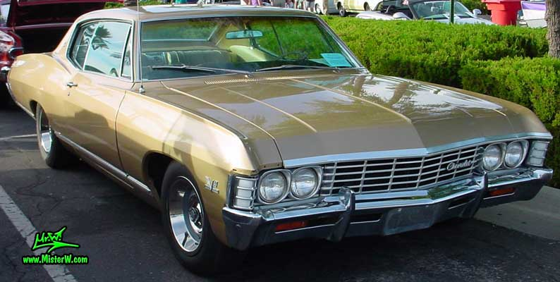 Photo of a gold braun 1967 Chevrolet Caprice 2 Door Hardtop Coupe at the Scottsdale Pavilions Classic Car Show in Arizona. 1967 Chevy Caprice