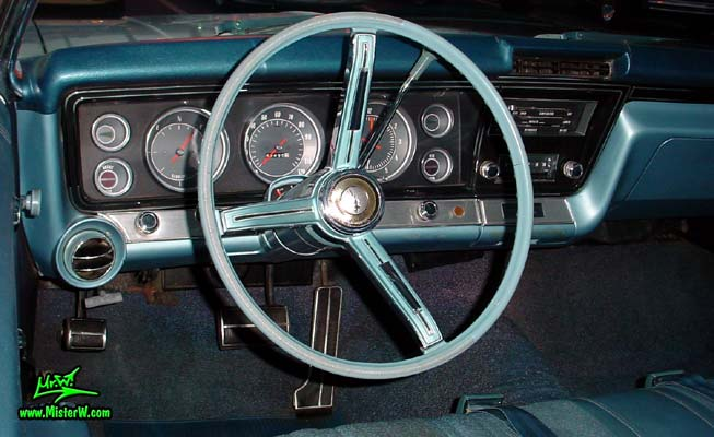 Photo of a white 1967 Chevrolet Impala 2 Door Hardtop Coupe at the Scottsdale Pavilions Classic Car Show in Arizona. Dash, Speedometer & Odometer of a 1967 Chevrolet Impala Coupe