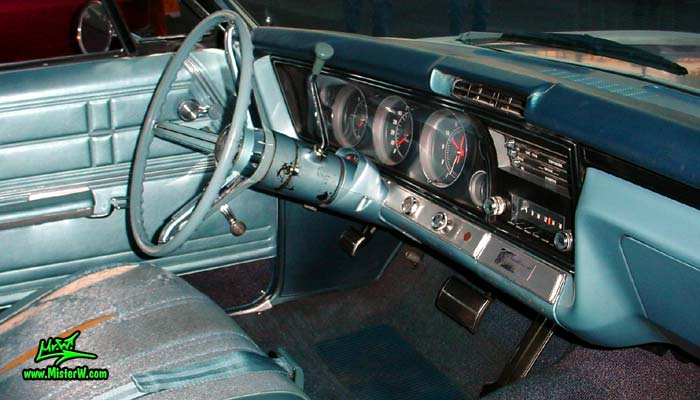 Photo of a white 1967 Chevrolet Impala 2 Door Hardtop Coupe at the Scottsdale Pavilions Classic Car Show in Arizona. 1967 Chevrolet Impala Steering Column & Dash Board