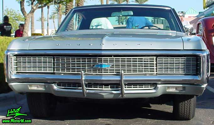 Photo of a silver grey 1969 Chevrolet 2 Door Hardtop Coupe at the Scottsdale Pavilions Classic Car Show in Arizona. 1969 Chevrolet Coupe