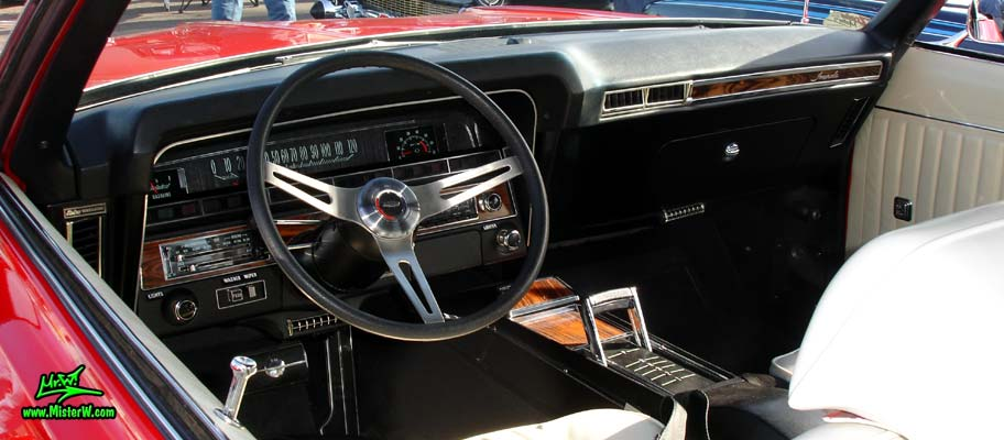 Photo of a red 1969 Chevrolet Impala convertible at the Scottsdale Pavilions Classic Car Show in Arizona. Dashboard & speedometer of a 1969 Chevrolet Impala convertible