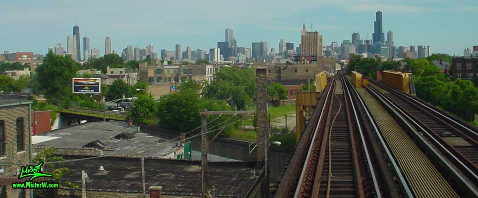 Photo of the downtown Chicago high rise skyscraper skyline, taken from a blue line subway train, close to the Western Milwaukee train station in summer 2004 The Skyline of Chicago