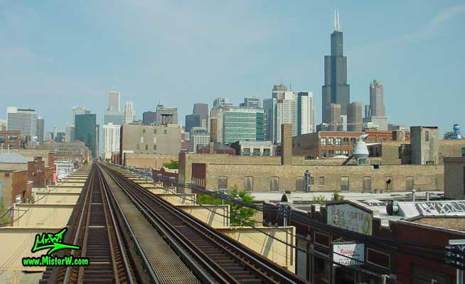 Photo of the downtown Chicago high rise skyscraper skyline, taken from a green line subway train, above Lake Street in summer 2004 The Skyline of Chicago from the Subway