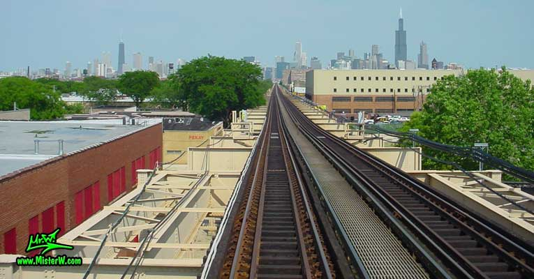 Photo of the skyline of downtown Chicago, taken from a green line subway train, above Lake Street in summer 2004 John Hancock Center, Aon Center & the Sears Tower from the Green Line