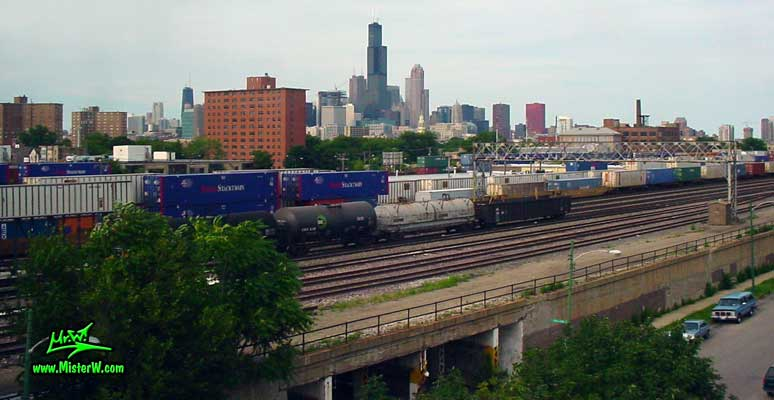 Photo of the Chicago skyline, taken from a blue line subway train close the 18th Street station in summer 2004 Freight Trains & Skyscraper Skyline of Downtown Chicago