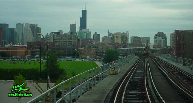Photo of the Chicago skyline, taken from a subway train close the Chicago (Brown, Purple Lines) Station in summer 2004 Subway Train & Sears Tower in Chicago