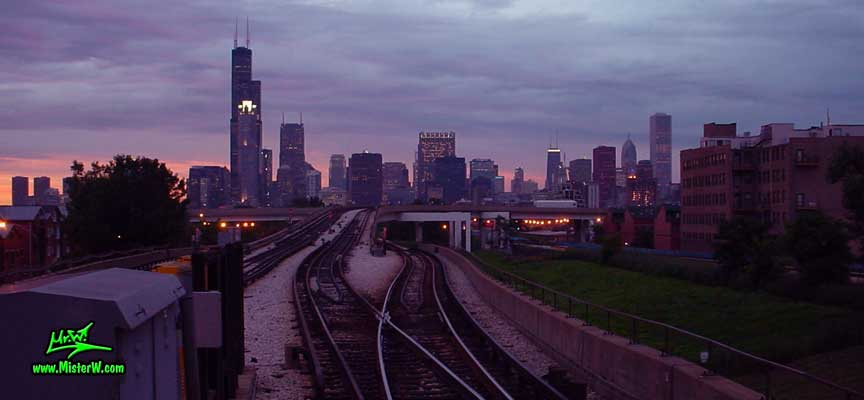Photo of the Chicago skyline, taken at sunset from the red line Cermak Chinatown subway train station in summer 2004<BR>Sears Tower, the 311 South Wacker building, AT&T Corporate Center, John Hancock Center, Two Prudential Plaza & Aon Center Sunset Skyscraper Skyline of Downtown Chicago