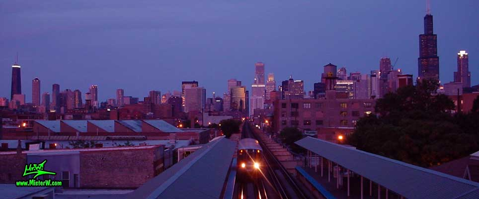 Photo of the Chicago skyline, taken at sunset, taken from the green line, Ashland / Lake Train Station in summer 2004 Sunset in Chicago