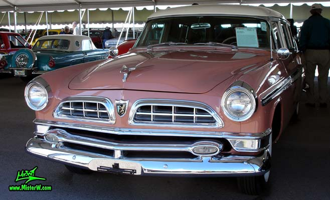 Photo of a pink & white 1955 Chrysler New Yorker Deluxe Town & Country Station Wagon at a classic car auction in Scottsdale, Arizona. 1955 Chrysler Deluxe Town & Country Station Wagon