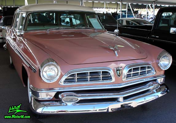 Photo of a pink & white 1955 Chrysler New Yorker Deluxe Town & Country Station Wagon at a classic car auction in Scottsdale, Arizona. Front Chrome Grill of a 55 Chrysler New Yorker Deluxe Town & Country Stationwagon