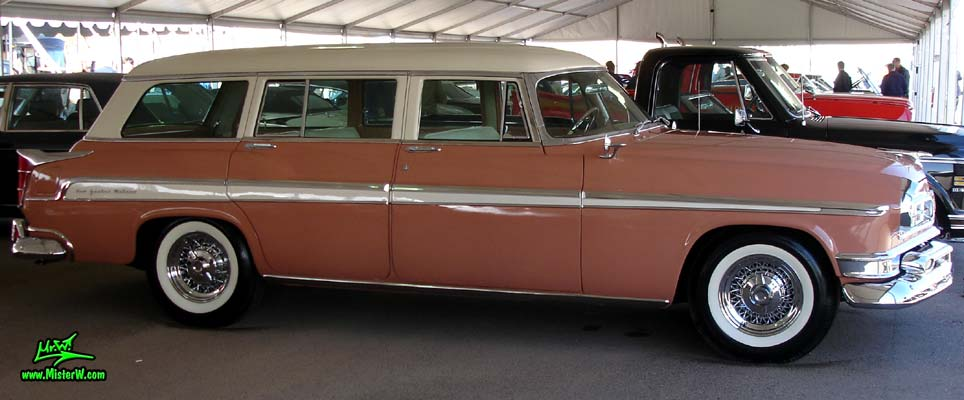 Photo of a pink & white 1955 Chrysler New Yorker Deluxe Town & Country Station Wagon at a classic car auction in Scottsdale, Arizona. 55 Chrysler Deluxe Town & Country Stationwagon