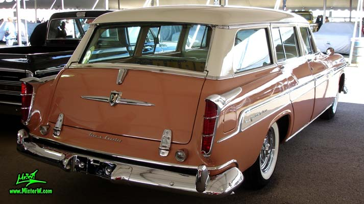 Photo of a pink & white 1955 Chrysler New Yorker Deluxe Town & Country Station Wagon at a classic car auction in Scottsdale, Arizona. 55 Chrysler New Yorker Deluxe Town & Country Stationwagon Tailfins