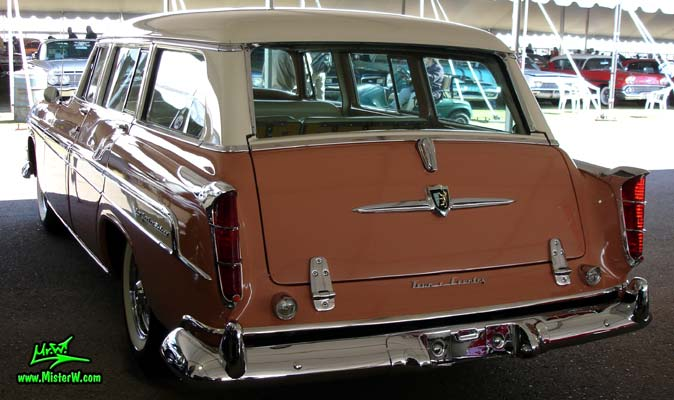 Photo of a pink & white 1955 Chrysler New Yorker Deluxe Town & Country Station Wagon at a classic car auction in Scottsdale, Arizona. Rearview of a 1955 Chrysler New Yorker Deluxe Town & Country Station Wagon