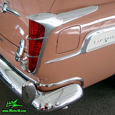 Photo of a pink & white 1955 Chrysler New Yorker Deluxe Town & Country Station Wagon at a classic car auction in Scottsdale, Arizona. Tail Fin of a 1955 Chrysler New Yorker Deluxe Town & Country Station Wagon