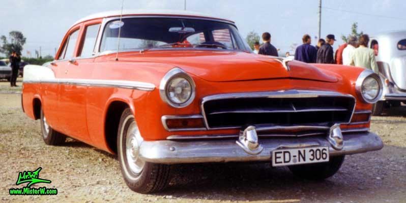 Photo of a red 1956 Chrysler 4 Door Hardtop Sedan at a classic car meeting in Germany. Frontview of 56 Chrysler Sedan