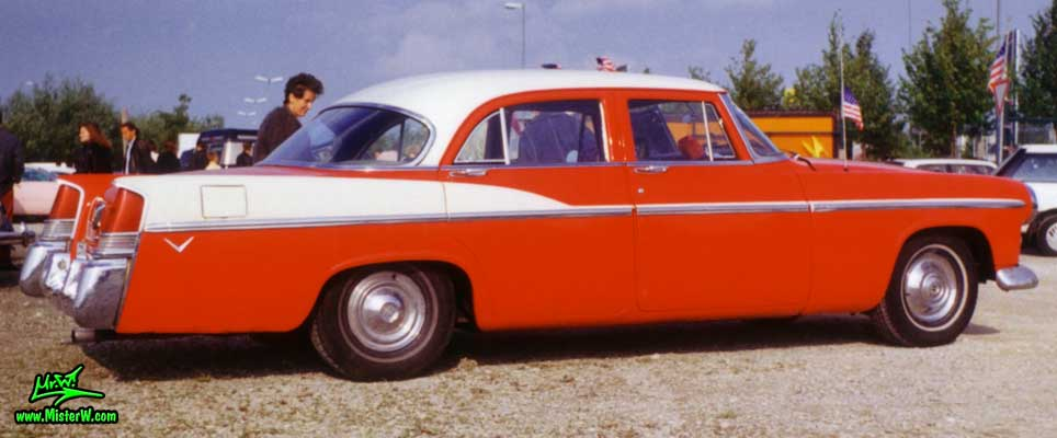 Photo of a red 1956 Chrysler 4 Door Hardtop Sedan at a classic car meeting in Germany. Sideview of 56 Chrysler Sedan