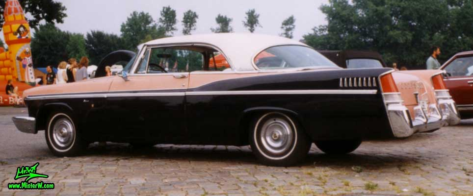 Photo of a pink & black 1956 Chrysler 2 Door Hardtop Coupe at a Classic Car Meeting in Germany. 1956 Chrysler Coupe Tail Fins