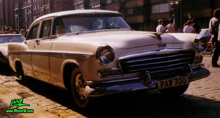 Photo of a white 1956 Chrysler 4 Door Hardtop Sedan at a classic car meeting on the St. Pauli Fischmarkt in Hamburg, Germany. 1956 Chrysler Front