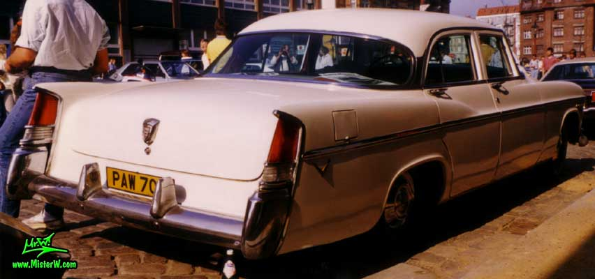 Photo of a white 1956 Chrysler 4 Door Hardtop Sedan at a classic car meeting on the St. Pauli Fischmarkt in Hamburg, Germany. 1956 Chrysler Back