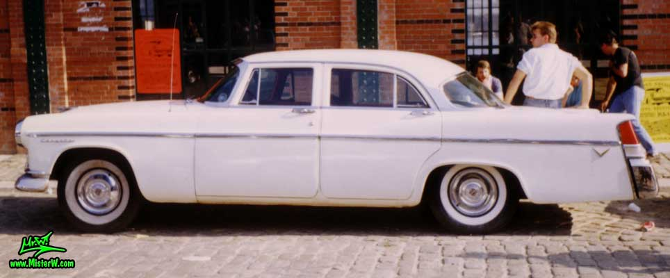 Photo of a white 1956 Chrysler 4 Door Hardtop Sedan at a classic car meeting on the St. Pauli Fischmarkt in Hamburg, Germany. 1956 Chrysler Side