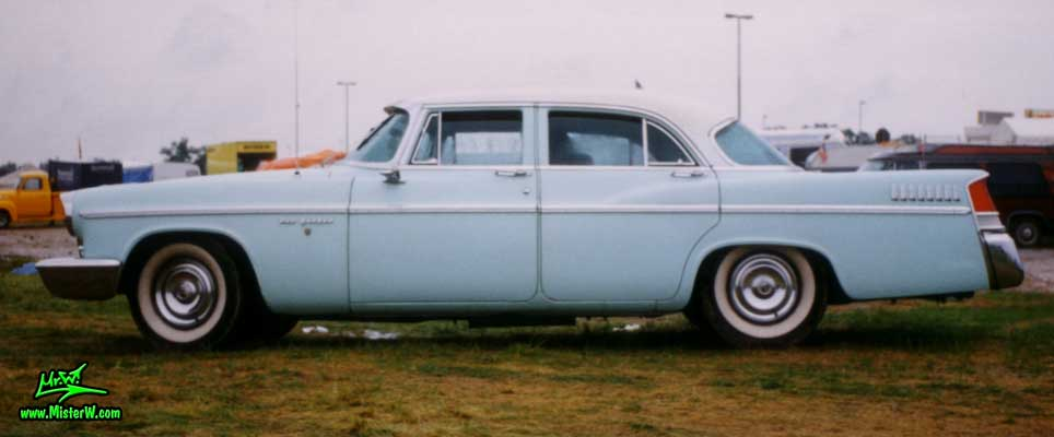 Photo of a blue 1956 Chrysler New Yorker 4 Door Hardtop Sedan at a classic car meeting in Germany. 1956 Chrysler New Yorker Sideview