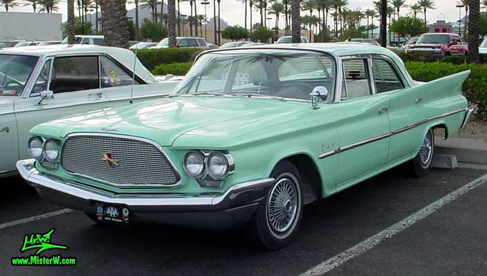Photo of a turquoise 1960 Chrysler 4 door sedan at the Scottsdale Pavilions Classic Car Show in Arizona. 1960 Chrysler 4 Door