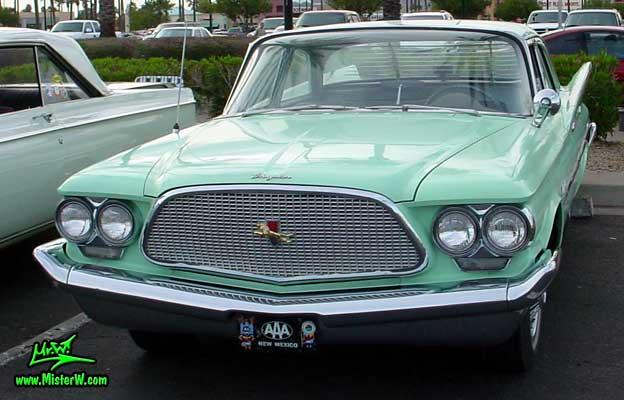 Photo of a turquoise 1960 Chrysler 4 door sedan at the Scottsdale Pavilions Classic Car Show in Arizona. Turkquoise 1960 Chrysler