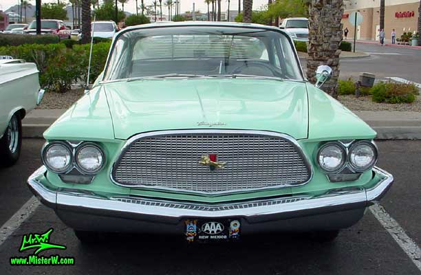 Photo of a turquoise 1960 Chrysler 4 door sedan at the Scottsdale Pavilions Classic Car Show in Arizona. 1960 Chrysler Chrome Grill