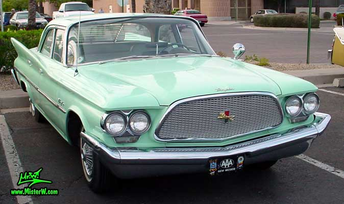 Photo of a turquoise 1960 Chrysler 4 door sedan at the Scottsdale Pavilions Classic Car Show in Arizona. Front view of a 1960 Chrysler