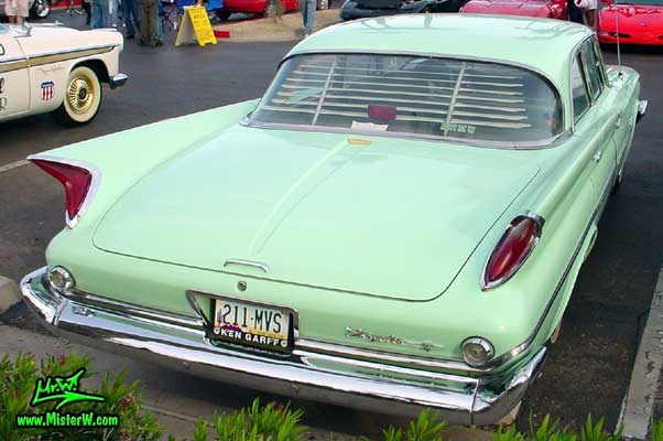 Photo of a turquoise 1960 Chrysler 4 door sedan at the Scottsdale Pavilions Classic Car Show in Arizona. Rear view of a 1960 Chrysler