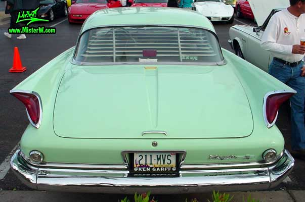 Photo of a turquoise 1960 Chrysler 4 door sedan at the Scottsdale Pavilions Classic Car Show in Arizona. 1960 Chrysler Tail Fins