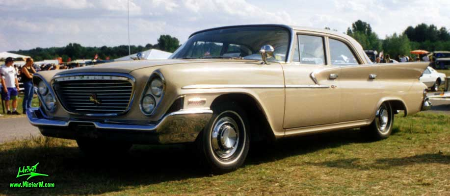 Photo of a tan 1961 Chrysler 4 Door Hardtop Sedan at a classic car meeting in Germany. 1961 Chrysler 4 Door