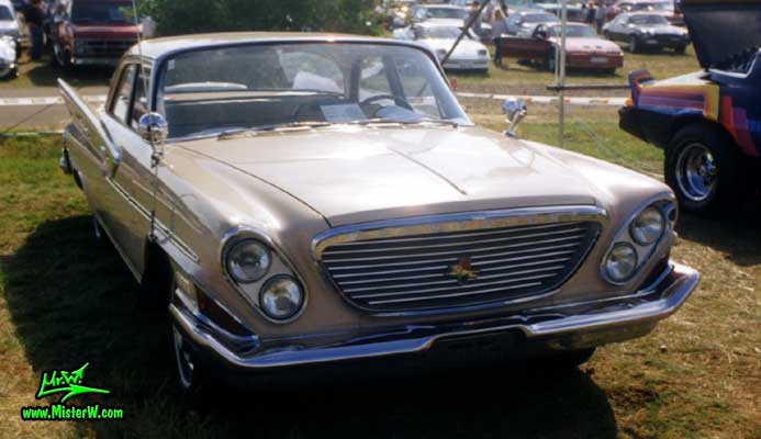 Photo of a tan 1961 Chrysler 4 Door Hardtop Sedan at a classic car meeting in Germany. 1961 Chrysler Sedan Front Grill
