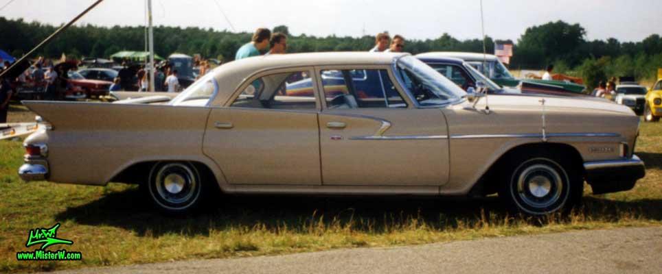 Photo of a tan 1961 Chrysler 4 Door Hardtop Sedan at a classic car meeting in Germany. 1961 Chrysler Sedan Sideview