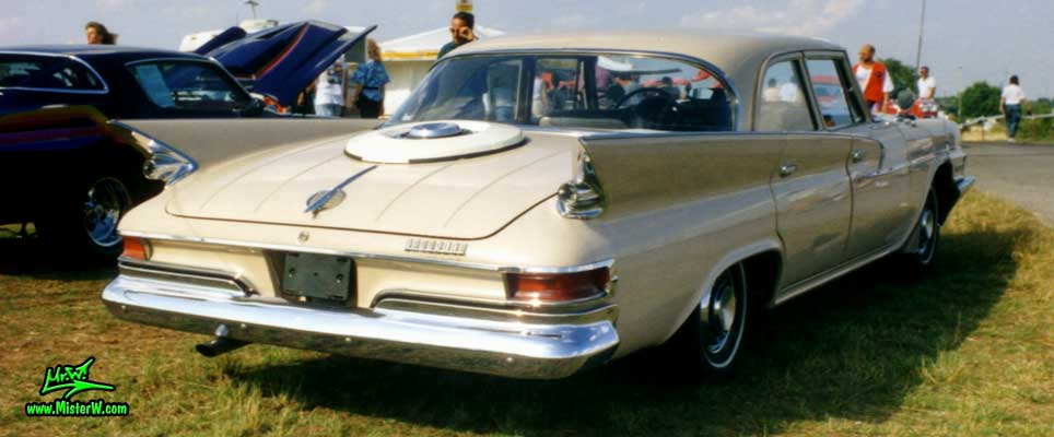 Photo of a tan 1961 Chrysler 4 Door Hardtop Sedan at a classic car meeting in Germany. 1961 Chrysler Sedan Rearview