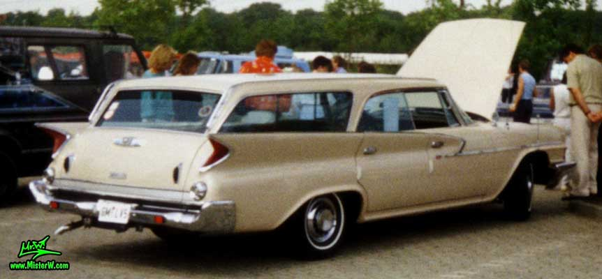 Photo of a tan 1961 Chrysler Newport 4 Door Hartop Station Wagon at a classic car meeting in Germany. 1961 Chrysler Wagon in Germany