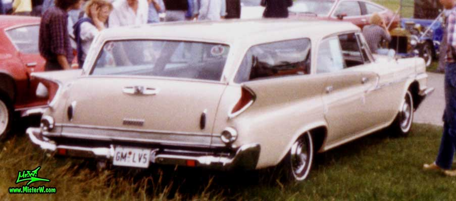 Photo of a tan 1961 Chrysler Newport 4 Door Hartop Station Wagon at a classic car meeting in Germany. 1961 Chrysler Newport Wagon at a Classic Car Show
