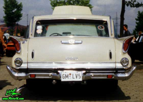 Photo of a tan 1961 Chrysler Newport 4 Door Hartop Station Wagon at a classic car meeting in Germany. 1961 Chrysler Wagon Rearview