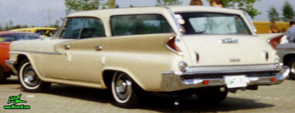 Photo of a tan 1961 Chrysler Newport 4 Door Hartop Station Wagon at a classic car meeting in Germany. 1961 Chrysler Wagon Sideview