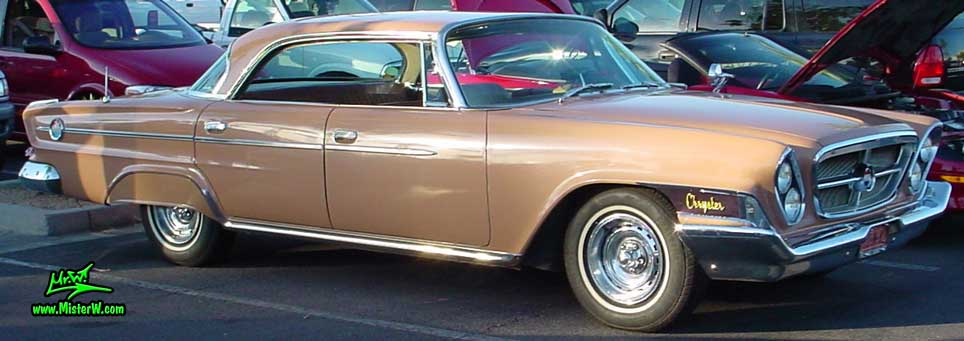 Photo of a peach rose pink 1962 Chrysler 300 4 Door Hardtop Sedan at the Scottsdale Pavilions Classic Car Show in Arizona. 62 Chrysler