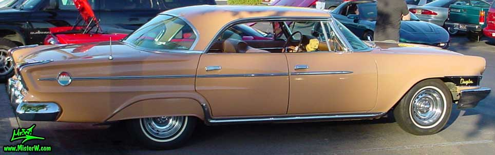 Photo of a peach rose pink 1962 Chrysler 300 4 Door Hardtop Sedan at the Scottsdale Pavilions Classic Car Show in Arizona. Sideview of a 1962 Chrysler 300 Sedan