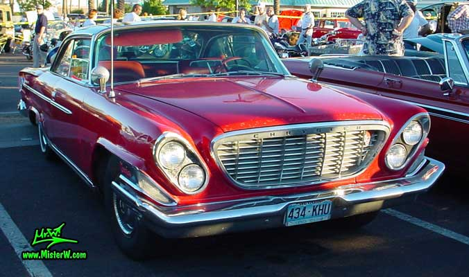 Photo of a red 1962 Chrysler 300 2 Door Hardtop Coupe at the Scottsdale Pavilions Classic Car Show in Arizona. 1962 Chrysler 300 Coupe