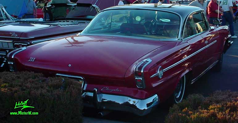 Photo of a red 1962 Chrysler 300 2 Door Hardtop Coupe at the Scottsdale Pavilions Classic Car Show in Arizona. 1962 Chrysler