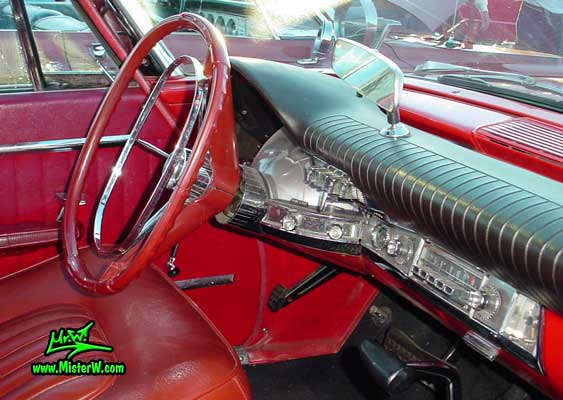 Photo of a red 1962 Chrysler 300 2 Door Hardtop Coupe at the Scottsdale Pavilions Classic Car Show in Arizona. Odometer & Dash Board of a 1962 Chrysler 300 Coupe