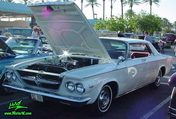 Photo of a white 1963 Chrysler 300 2 Door Hardtop Coupe at the Scottsdale Pavilions Classic Car Show in Arizona. 1963 Chrysler 300 Coupe