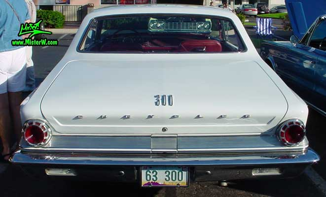 Photo of a white 1963 Chrysler 300 2 Door Hardtop Coupe at the Scottsdale Pavilions Classic Car Show in Arizona. Back of a 1963 Chrysler 300