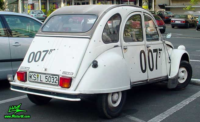 Photo of a white Citroen 2CV 4 Door Hardtop Sedan in Kassel, Germany. 007 Citroen 2CV with Bullet Holes