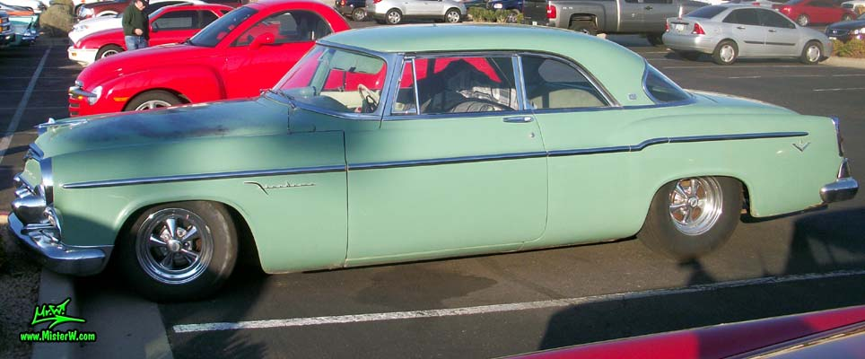Photo of a turquoise 1955 Chrysler DeSoto Firedome 2 Door Hardtop Coupe at the Scottsdale Pavilions Classic Car Show in Arizona. 55 DeSoto Firedome Coupe